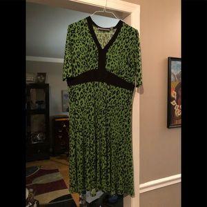 Stunning dress. Fits like a 14. Nice finishes.